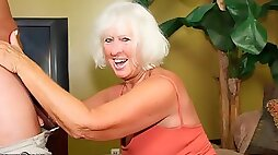 Cute amateur blonde granny Jeannie knows how to suck a brown cock
