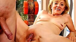 Blonde granny is getting her pussy licked and banged by a young nerd