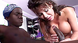 Busty brunette with her nice ass gets a cunnilingus from the midget