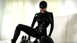 Latex mistress playing around with her gimp slave