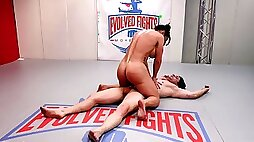 Busty Brandi Mae holds her own during sexy wrestling match with a male