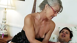 years old bitch in glasses seduced her young neighbor and sucked him off on sofa