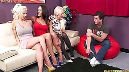 Amateur women sit clothed when faced with sharing a cock