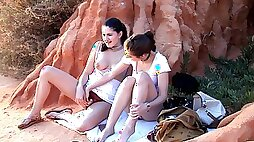 Sensual teens are having a wonderful time sharing the dildo at sunset