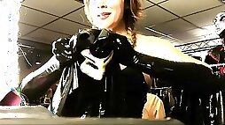 Naughty mom tries on that kinky latex costume for us