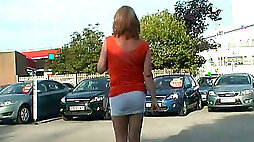 Filming sexy skanky tranny on the parking lot in different clothes
