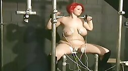 This submissive redhead babe with huge natural tits is no stranger to electro play