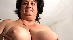 She is a horny mature whore with a gargantuan set of breasts