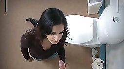 Slim hot brunette in high boots Jennifer gives blowjob for cum in the WC