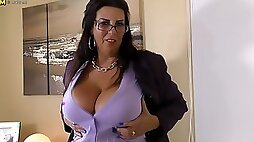 Horny mature girl with huge tits toys herself with rubber dildo