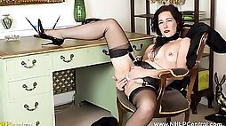 Sexy Secretary Strips Off Panties Fingers her wet Pussy In Black Nylons And Heels